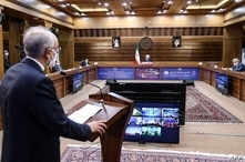 A handout picture provided by the Iranian presidential office on April 10, 2021, shows  the head of the Atomic Energy…