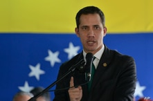 Opposition leader Juan Guaido speaks during a press conference in Caracas, Venezuela, Monday, March 9, 2020. (AP Photo/Matias…