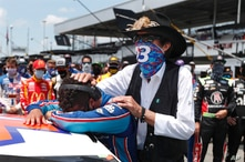 NASCAR driver Bubba Wallace is consoled by team owner Richard Petty, right, prior to the start of the NASCAR Cup Series at the…