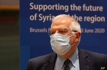 European Union foreign policy chief Josep Borrell waits for the start of a meeting, Supporting the future of Syria and the…