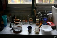 Freshly brewed coffee stands on a table in a trailer at the National Circus Foundation of Venezuela, in the circus enclosure of…
