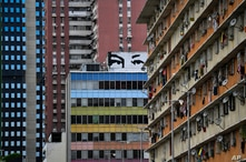 """A mural depicts """"Chavez's eyes"""" a design based on the eyes of the late Venezuelan President Hugo Chavez, during Independence…"""