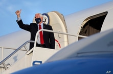 Vice President Mike Pence gives a thumbs-up before departing on Air Force Two from Philadelphia International Airport after a…