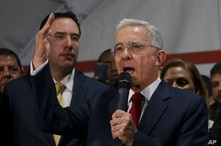 Former Colombian President Alvaro Uribe speaks to supporters gathered at the Democratic Center Party headquarters in Bogota,…