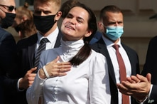 Belarusian opposition leader Sviatlana Tsikhanouskaya interacts with supporters in Warsaw, Poland, Wednesday, Sept. 9, 2020…