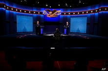 President Donald Trump, left, and Democratic presidential candidate former Vice President Joe Biden, right, with moderator…
