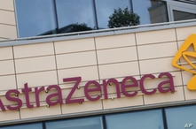 FILE - This Saturday, July 18, 2020 file photo shows a general view of AstraZeneca offices and the corporate logo in Cambridge,…