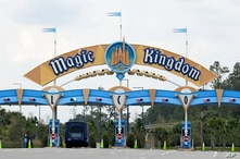 FILE - In this March 16, 2020, file photo, the entrance to the parking lot at the Magic Kingdom at Walt Disney World is closed…