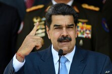Venezuelan President Nicolas Maduro speaks at a press conference at the Miraflores Presidential Palace in Caracas, Venezuela,…