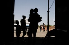 FILE - In this Wednesday, May 22, 2019 file photo migrants mainly from Central America guide their children through the…