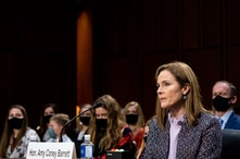 Supreme Court nominee Amy Coney Barrett listens during a confirmation hearing before the Senate Judiciary Committee, Wednesday,…