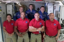In this frame grab from NASA TV, SpaceX Dragon crew, from front left to right, Shannon Walker, Victor Glover, Mike Hopkins and…