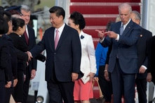 Vice President Joe Biden gestures toward Chinese President Xi Jinping and his wife Peng Liyuan during an arrival ceremony in…