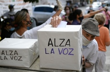 An elderly man votes in a consultation organized by the opposition to reject the government of President Nicolas Maduro in…