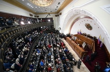 Incoming lawmakers members fill the chamber of the National Assembly during the year's first session in Caracas, Venezuela,…