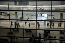 People in the arrivals area at Heathrow Airport in London, Tuesday, Jan. 26, 2021, during England's third national lockdown…