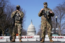 National Guard keep watch on the Capitol, Thursday, March 4, 2021, on Capitol Hill in Washington. Capitol Police say they have…