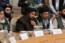 Taliban co-founder Mullah Abdul Ghani Baradar, center, with other members of the Taliban delegation attend an international…