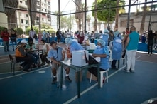 Health workers inoculate people with a dose of the Sputnik V COVID-19 vaccine at the 23 de Enero neighborhood in Caracas,…