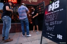 FILE PHOTO: Bars reopen in Austin after being shut down to stop the spread of the coronavirus disease (COVID-19)