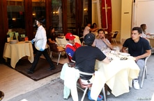 People eat at outdoor seating at Cipriani Downtown restaurant as phase one reopening continues in New York
