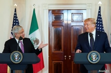FILE PHOTO: U.S. President Trump and Mexico's President Lopez Obrador make joint statements before dinner at the White House in Washington