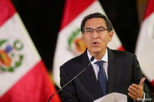 FILE PHOTO: FILE PHOTO: Peru's President Vizcarra addresses the nation at the government palace in Lima