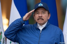 Nicaragua's President Daniel Ortega salutes during a ceremony to mark the 199th Independence Day anniversary, in Managua