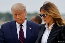 U.S. President Donald Trump and first lady Melania Trump arrive at Cleveland Hopkins International Airport to participate in the first presidential debate with Democratic presidential nominee Joe Biden in Cleveland, Ohio