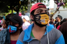 People wear protective masks while attending the festivities in honour of San Jeronimo, as the coronavirus disease (COVID-19) outbreak continues in Masaya
