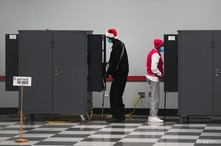 People cast their ballots in the U.S. Senate runoff elections on the first day of early voting in Atlanta