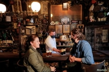 Restrictions ease for bars, allowing seating at the bar, during the coronavirus disease (COVID-19) in Manhattan, New York City