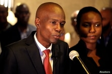 FILE PHOTO: Jovenel Moise addresses the media next to his wife Martine after winning Haiti's 2016 presidential election