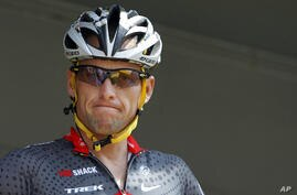 In this July 6, 2010, file photo, Lance Armstrong grimaces prior to the start of the third stage of the Tour de France cycling race in Wanze, Belgium.