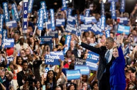 President Barack Obama and Democratic presidential candidate Hillary Clinton wave as they appear on stage together on the third day session of the Democratic National Convention in Philadelphia, July 27, 2016.