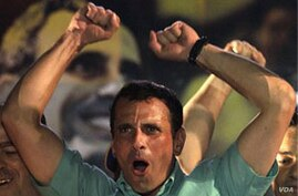 Henrique Capriles celebrates after wining the opposition presidential primary in Caracas, Venezuela, Sunday Feb. 12, 2012. Capriles won Venezuela's first-ever opposition presidential primary Sunday by a wide margin, emerging as the single candidate who wi