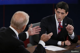 U.S. Vice President Joe Biden (L) and Republican vice presidential nominee Paul Ryan discuss a point during the U.S. vice presidential debate in Danville, Kentucky, October 11, 2012.     REUTERS/Rick Wilking (UNITED STATES  - Tags: POLITICS ELECTIONS USA