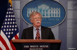U.S. National Security Advisor John Bolton speaks about election security in the White House press briefing room at the White House in Washington,  Aug.  2, 2018.