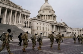 Members of the National Guard arrive at the U.S. Capitol, January 11, 2021, days after supporters of U.S. President Donald Trump stormed the Capitol in Washington.