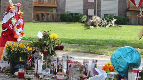 An tribute in honor of teenager Michael Brown who was shot and killed by a police officer, Ferguson, Missouri, Aug. 24, 2014. (Gesell Tobias, VOA)