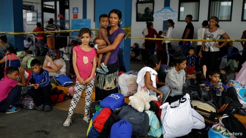 Venezuelan migrant Maria Valdez, 31, poses for a picture with her children Yoimairy, 9, and Darien, 1, while they wait to…