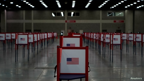 Voting booths stand on the floor of the Expo Center on the day of the primary election in Louisville, Kentucky, U.S. June 23,…