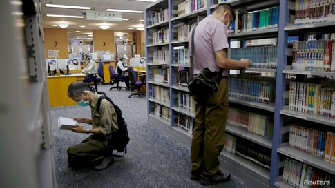 People read books at Hong Kong Central Library after democracy activists' books were taken down due to national security law in…