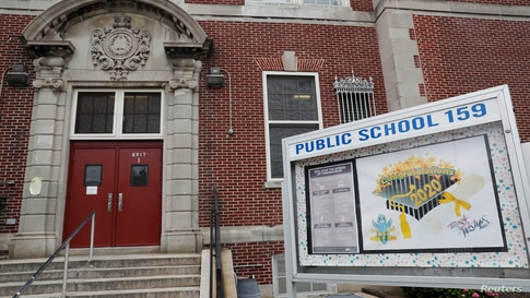 The entrance to Public School 159 is seen in the Queens borough of New York City, New York, U.S., July 8, 2020.   REUTERS…