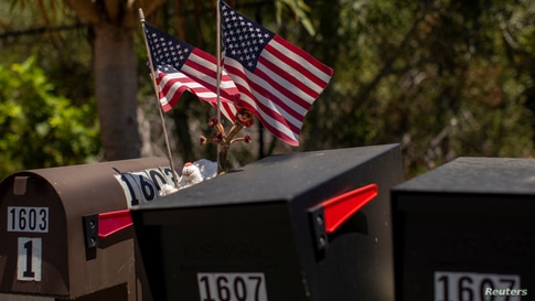 Residents decorate their U.S. postal mail boxes with U.S. flags during the outbreak of the coronavirus disease (COVID-19) in…