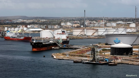 FILE PHOTO: Crude oil tankers are docked at Isla Oil Refinery PDVSA terminal in Willemstad on the island of Curacao, February…