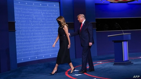 US President Donald Trump and US First Lady Melania Trump leave the stage at the end of the final presidential debate at…
