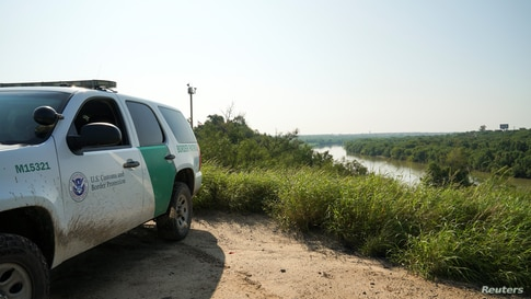 A Border Patrol vehicle is seen near the Rio Grande in Laredo, Texas, U.S., September 19, 2020. Picture taken September 19,…