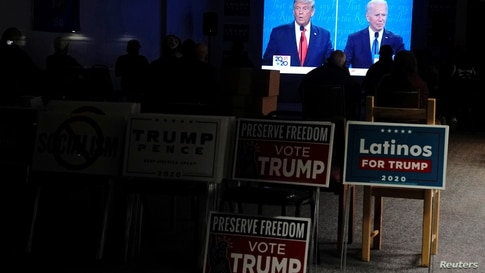 Supporters of U.S. President Donald Trump watch the final 2020 presidential debate between U.S. President Donald Trump and…