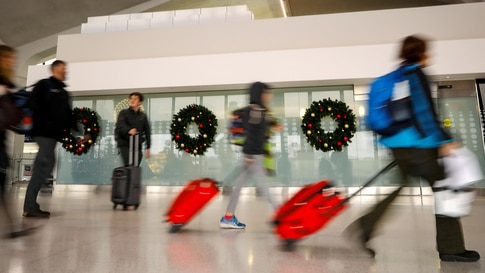 Travelers make their way to flights at Newark International Airport ahead of the Thanksgiving holiday in Newark, New Jersey, U…